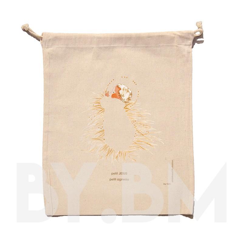 Bolsa de algodón orgánico con una ilustración artística original que representa al pequeño Jesús en la paja del pesebre